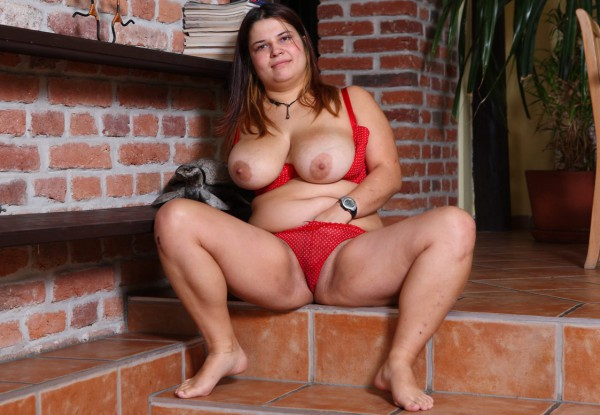 Young plumper Anastasia posing in red lingerie