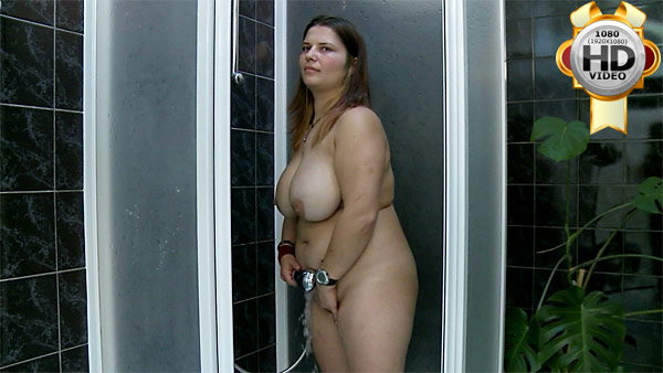 Plump girl washing her chubby body in shower