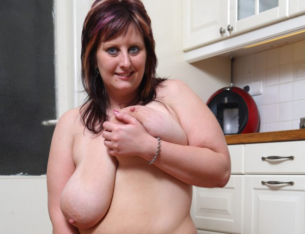 Chubby Vickie with great giant boobs posing on the kitchen