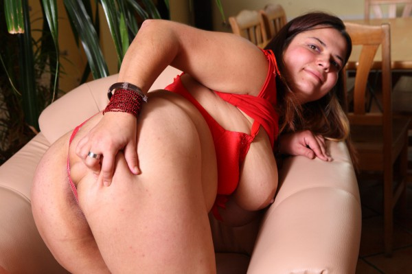 Plump girl Anastasia posing in red lingerie