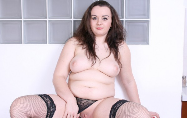 BBW in black stockings exposing pussy lips