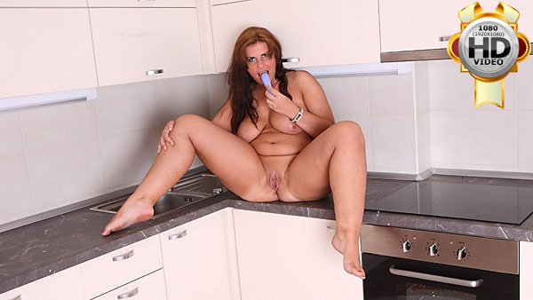 Hot BBW plays with rubber dildo