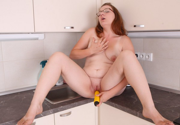 Young BBW plays with plastic banana