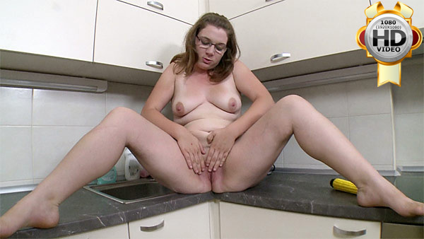 BBW masturbates in kitchen