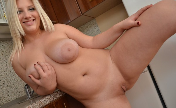 Chubby blonde busty spreads the lips of her pussy